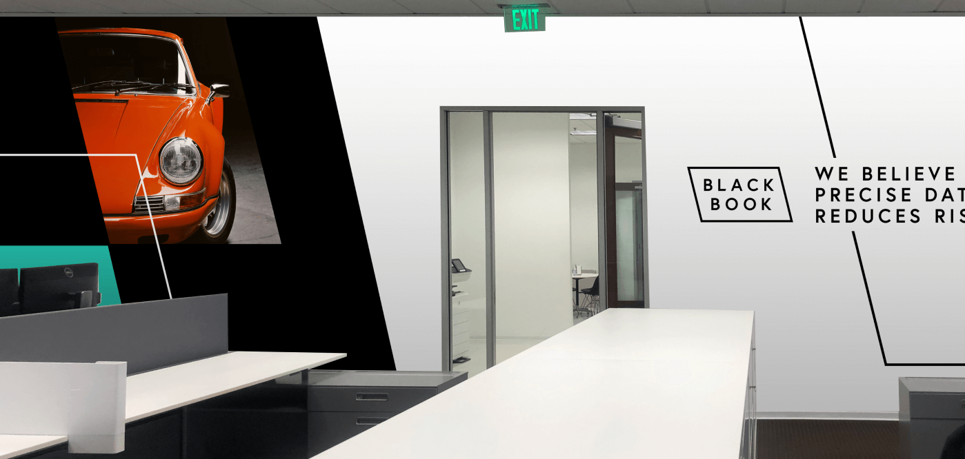 example of new black book branding on the walls at their office